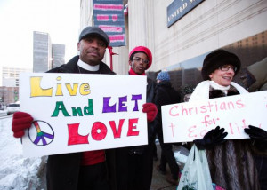 Gay marriage supporters at a federal courthouse in Detroit, Michigan ...