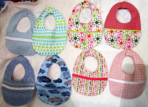 Here are a few bibs I made for the guilds boutique. We had a pricing ...