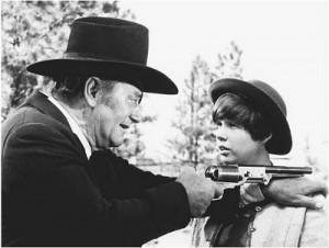 Rooster Cogburn shows Mattie Ross how to fire a pistol. John Wayne's