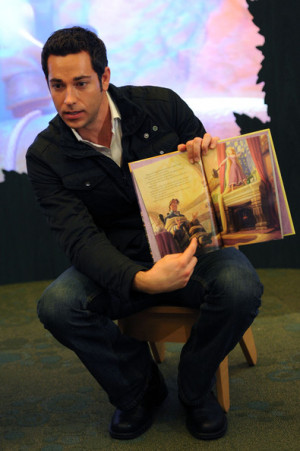 ... this photo zachary levi actor zach levi reads to children to promote