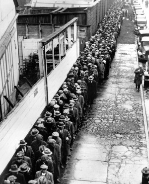 The Associated Press In this 1932 file photo, long line of jobless and ...