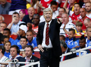 Making his point: Arsenal manager Arsene Wenger has had two bids ...