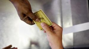 100620211-credit-card-exchange-hands-getty.530x298.jpg