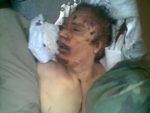 Deceased Libyan leader Muammar Gaddafi's is seen in a vehicle on the ...