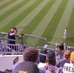 Torii Hunter taking a selfie with a fan during the Twins v Pirates ...