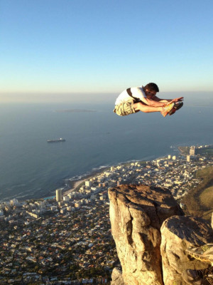 daring flying kick at Lion's Head, Cape Town, South Africa ...
