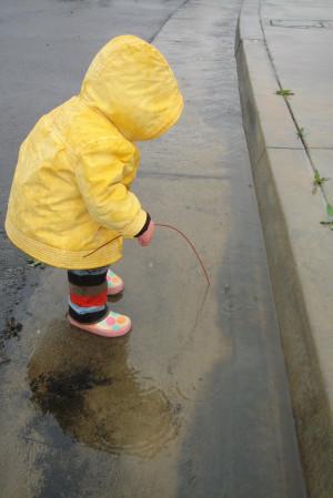 ... his sister's rain jacket and rain boots (pink soles with polka dots