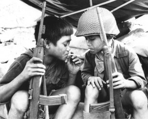 Vietcong child fighters share a cigarette, 1967