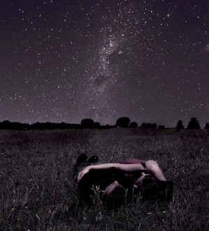 Couple laying out under the night sky