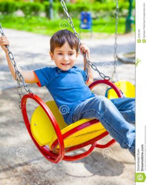 Swinging On A Swing Boy swinging on a swing on