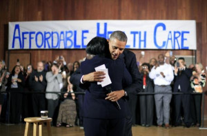 President Barack Obama hugs Edna Pemberton, who introduced him, before ...