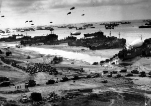 Allied soldiers, vehicles and equipment swarm onto the French shore ...