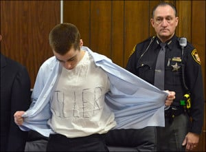 Lane unbuttons his shirt during sentencing Tuesday, March 19 ...