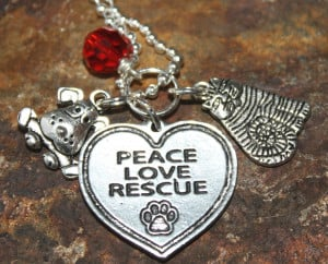 This necklace has a beautiful Peace Love Rescue charm with cute dog ...