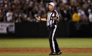 Replacement referee Jim Core questions a call during the season ...
