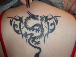 tribal dragon tattoos for girls. Tribal Dragon Tattoo on the upper ...