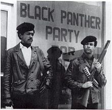Black Panther Party founders Bobby Seale and Huey P. Newton standing ...