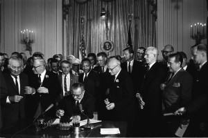 President Lyndon Johnson signs the Civil Rights Act of 1964 into law ...