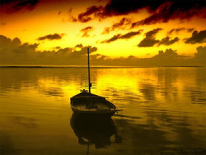 Maldives sunrise and boat by Badruddeen @ flickr
