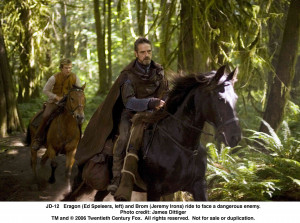 Eragon (Ed Speleers, left) and Brom (Jeremy Irons) ride to face a ...