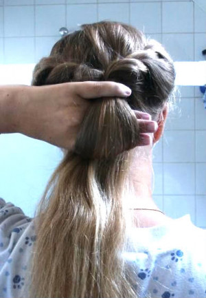 Wrap the rest of your hair around the base of the loop, covering the ...