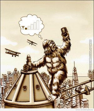 funny-picture-king-kong-checking-his-mobile-signal.jpg