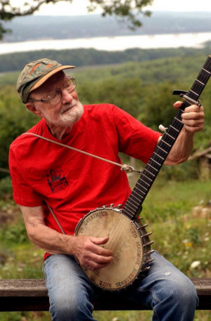 Pete Seeger, then 85, sits on his porch in 2004 above the Hudson River ...