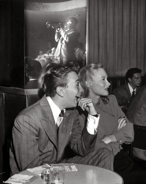 Mel Torme and model June Bright watching Dizzy Gillespie live in a ...