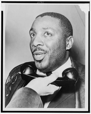 Dick Gregory interviewed on telephone, 1964. Photo Credit: Herman ...