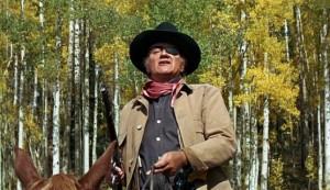 "Description: John Wayne as Marshal Reuben J. ""Rooster"" Cogburn to ..."
