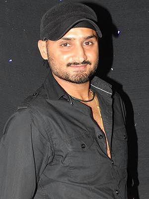 Harbhajan Singh With His Wife