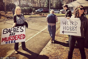 ... life activists outside an abortion clinic near their home in Raleigh