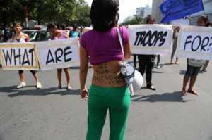 Military Slogans Filipino women hold slogans