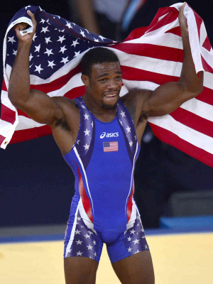 Jordan Burroughs celebrates with the U.S. flag after defeating Iran's ...