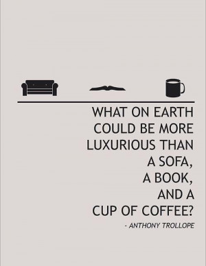 sofa, a book, and a cup of coffee