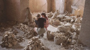 Dr Estelle Lazer, right, and a volunteer examine bones in Pompeii ...