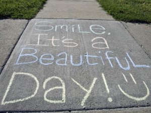 Chalking reads 'Smile, It's a Beautiful Day!'