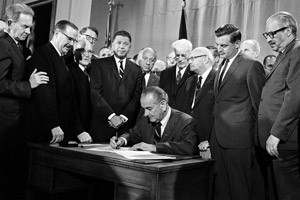 President Lyndon B. Johnson signs into law the Fair Housing Act during ...