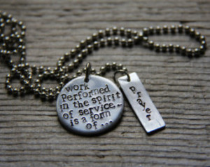 Hand-stamped quote from the Baha'i writings,