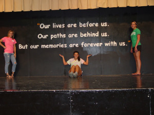 ... quote on the stage wall in preparation for graduation on May 19, 2013