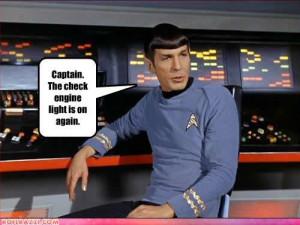 Spock checks the console – again.