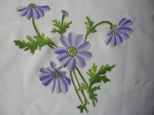 Painted flowers on fabric