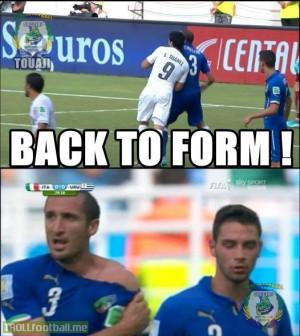 Suarez bites Chiellini in his shoulder...