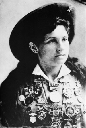 Annie Oakley, American sharpshooter and performer, is shown with a ...