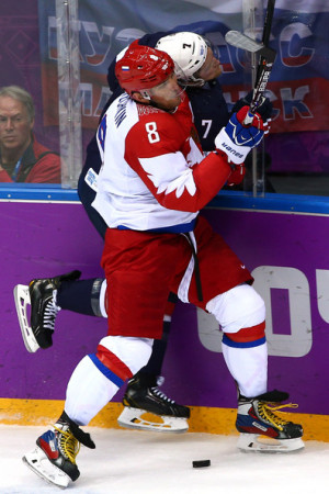 Paul Martin Alexander Ovechkin 8 of Russia checks Paul Martin 7 of
