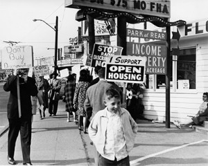 Protesters holding signs march at a demonstration in 1964 in Seattle ...