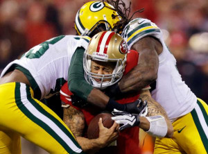 49ers quarterback Colin Kaepernick (7) is tackled by Green Bay Packers ...