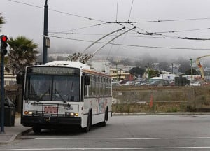 Muni bus waits to pick up passengers at Ocean Avenue and Phelan ...