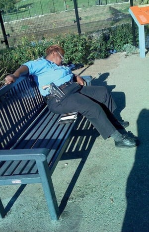 Female Police Officer with Gun Sleeping on the Job