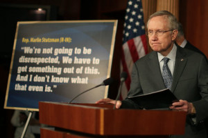 Harry Reid stands next to a quote from Marlin Stutzman during a news ...